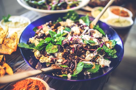 Spinach salad with cranberries, cheese and onions.