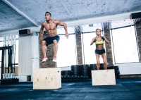 man and woman doing box jumps, a type of plyometric exercise
