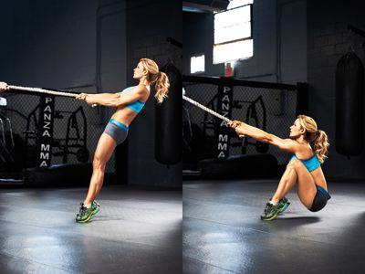 Female doing rope squats with the TRX Cables