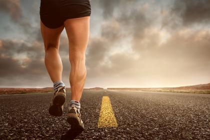 Picture of a man's thighs while running on an empty road